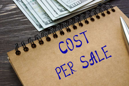 Financial concept about COST PER SALE with phrase on the page. Stockfoto