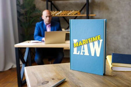 MARITIME LAW inscription on the book. Maritime law, also known as admiralty law, is a body of laws, conventions.