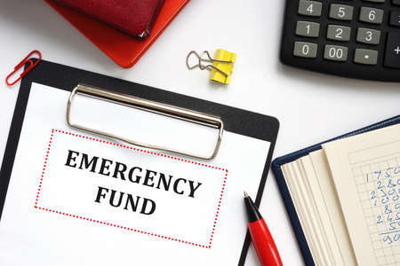 Financial concept meaning EMERGENCY FUND with inscription on the piece of paper.