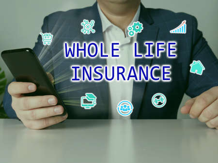 WHOLE LIFE INSURANCE text in search line. Businessman looking at smartphone. Stockfoto