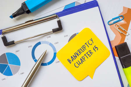 Financial concept meaning BANKRUPTCY CHAPTER 15 with sign on the piece of paper.