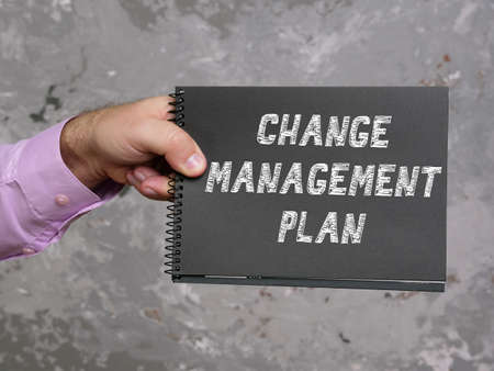 Business concept meaning CHANGE MANAGEMENT PLAN with sign on the sheet. Stockfoto
