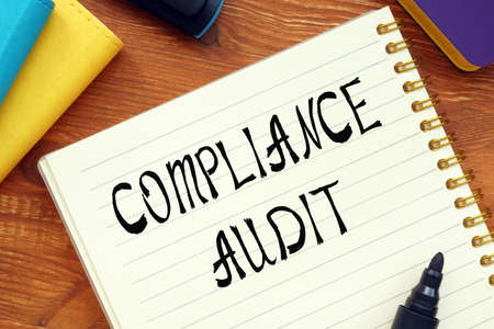 COMPLIANCE AUDIT question marks inscription on the piece of paper.