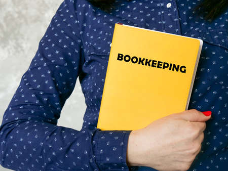 Financial concept about BOOKKEEPING with inscription on the piece of paper. Stockfoto