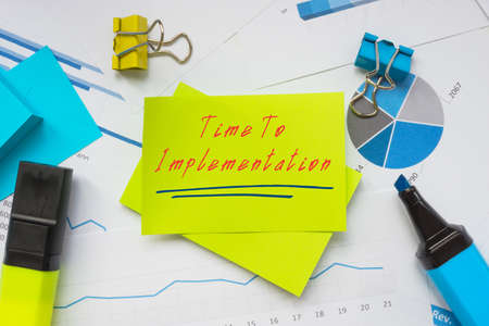Financial concept meaning Time To Implementation with inscription on the sheet. Stockfoto