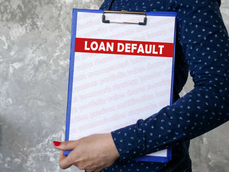 Financial concept meaning LOAN DEFAULT with inscription on the sheet.