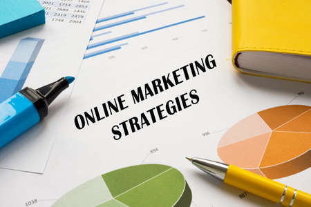 Business concept about ONLINE MARKETING STRATEGIES with phrase on the piece of paper.