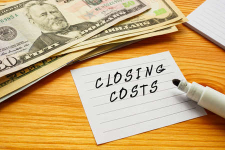 Business concept meaning CLOSING COSTS with phrase on the page.