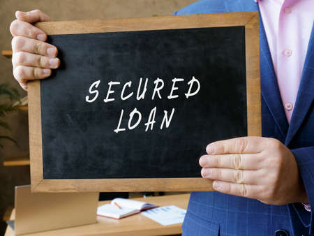 Business concept meaning SECURED LOAN with phrase on the blackboard.
