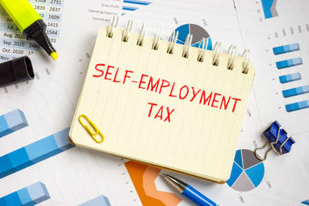 Financial concept about Self-Employment Tax with inscription on the sheet.
