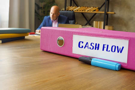 Business concept about CASH FLOW with sign on the File Folder.