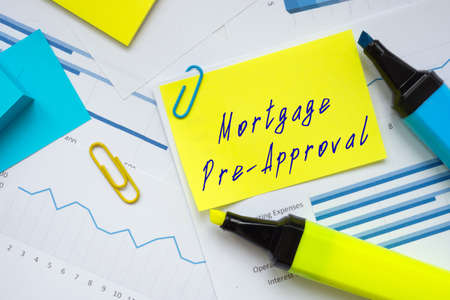 Business concept meaning Mortgage Pre-Approval with inscription on the sheet.