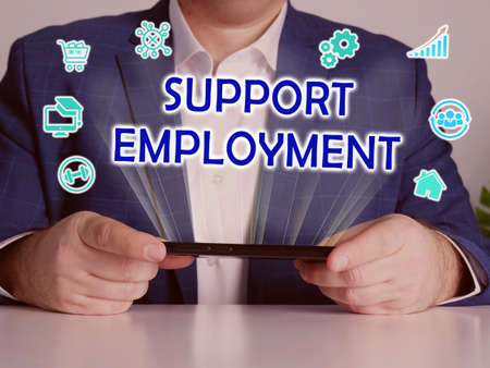 SUPPORT EMPLOYMENT inscription on the screen. Close up Bookkeeping clerk hands holding black smart phone.