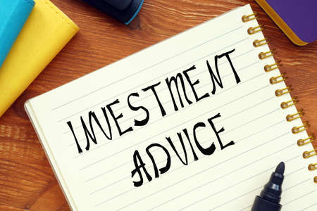 Financial concept about INVESTMENT ADVICE question marks with sign on the sheet. Stockfoto