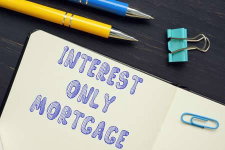 Business concept about INTEREST ONLY MORTGAGE with sign on the piece of paper.