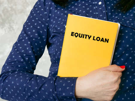 Financial concept about EQUITY LOAN with phrase on the piece of paper.