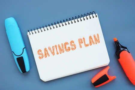Financial concept meaning SAVINGS PLAN with phrase on the piece of paper. Stockfoto