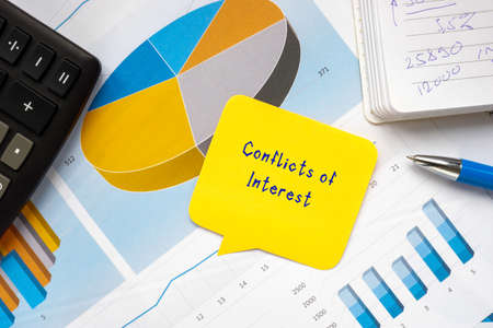 Business concept meaning Conflicts of Interest with phrase on the piece of paper. Stockfoto