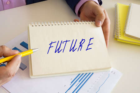Business concept about FUTURE with inscription on the jotter.