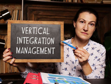 Business concept about VERTICAL INTEGRATION MANAGEMENT with phrase on the chalkboard