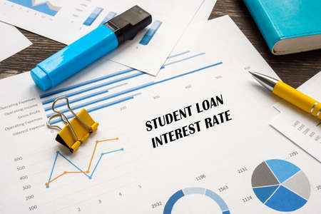 Financial concept meaning Student Loan Interest Rate with sign on the sheet. Stockfoto
