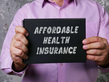 Business concept about AFFORDABLE HEALTH INSURANCE with sign on the piece of paper.