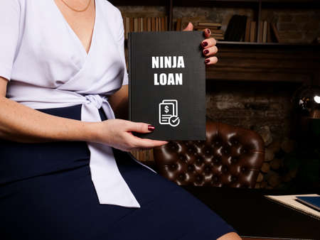 Financial concept meaning No income, no job, no assets NINJA LOAN with inscription on blank notepad. Stockfoto