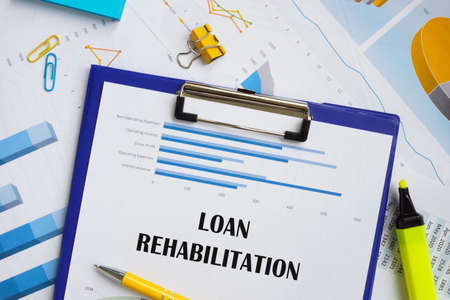 Financial concept meaning Loan Rehabilitation with inscription on the piece of paper.