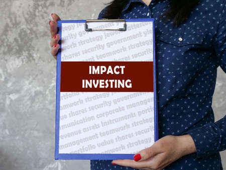 Financial concept meaning IMPACT INVESTING with inscription on the page. Stockfoto
