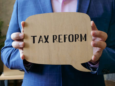 Business concept meaning TAX REFORM with sign on the sheet.