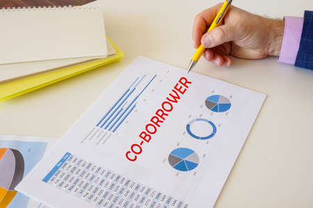 Financial concept about CO-BORROWER with inscription on the sheet.
