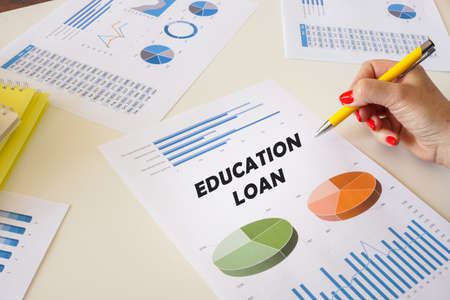 Business concept meaning EDUCATION LOAN with sign on the chart sheet.