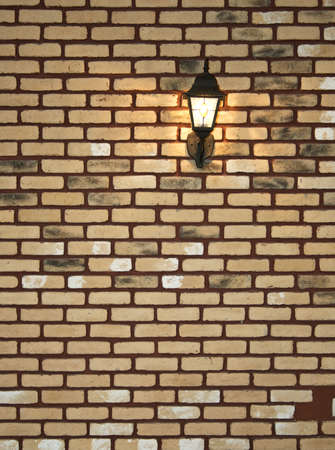 Electric lantern in old style on a wall photo