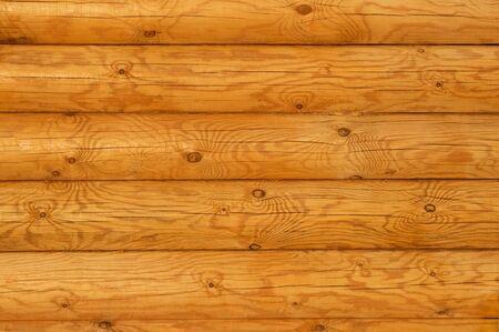 Wooden wall from logs in decline beams Standard-Bild