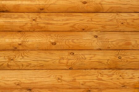 log on: Wooden wall from logs in decline beams Stock Photo