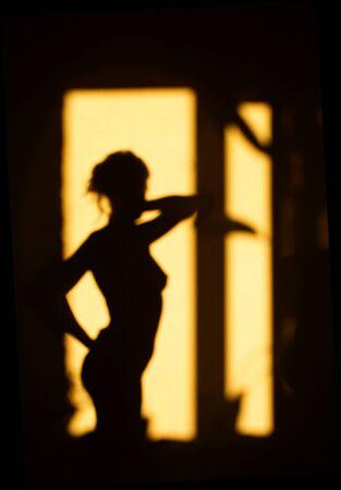 Female figure in morning light photo