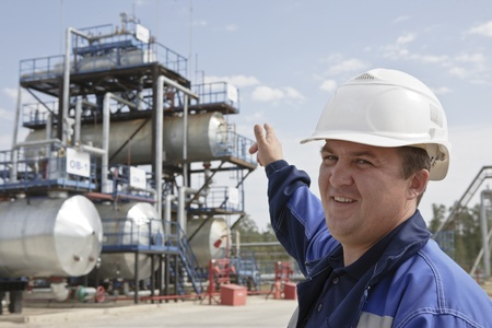 Oil worker in industrial oil and fuel plant photo