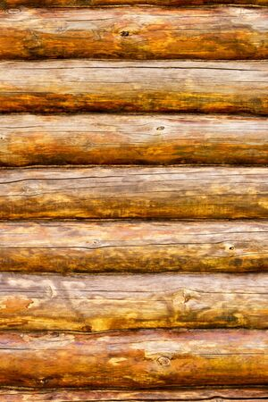 Wooden wall from logs in decline beams photo