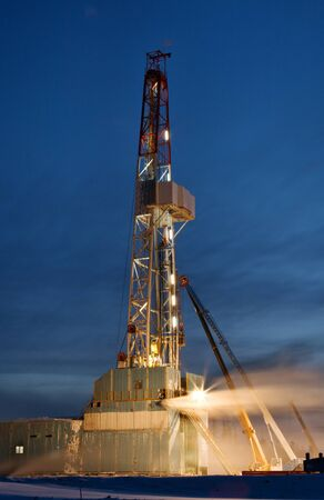 drilling rig: Derrick erection in western Siberia. The drilling beginning.