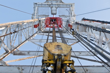 skidding: Drilling tower inside with crab for drilling well Editorial