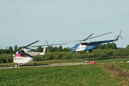airfoil: Two Helicopter on a platform before launch. One already in air
