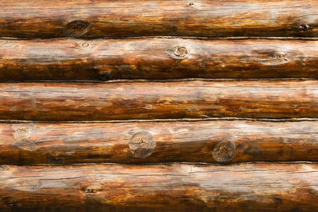 log: Wooden wall from logs in decline beams Stock Photo