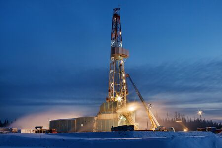 Derrick erection in western Siberia. The drilling beginning. photo
