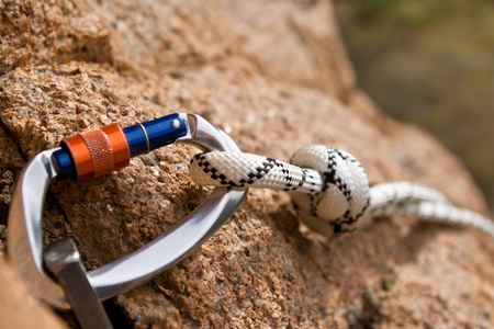 Carbine and hook with rope in stone