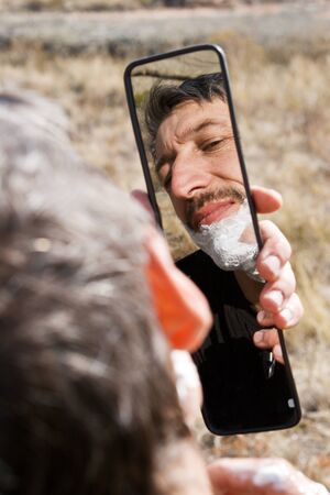 Portrait man shaving outdoor Stock Photo - 10751260