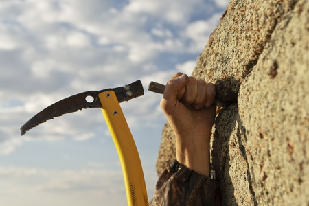 Work of the rock-climber against the sky and mountains photo