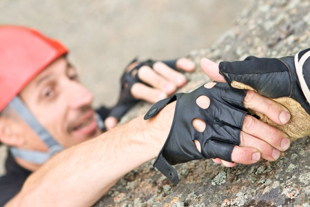 Two climbers keeping capture by hands in mountains photo