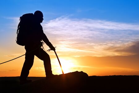 ice axe: The lonely rock-climber going on top of mountain Stock Photo