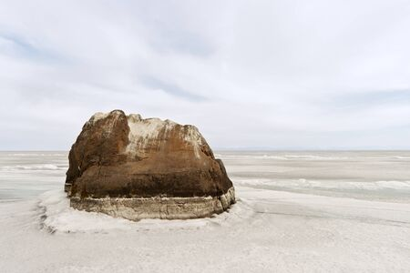 dullness: The lonely rock in the center of Lake Baikal in the winter Stock Photo