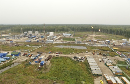 bogs: Field on production of hydrocarbons in the Siberian bogs. Top view. Stock Photo